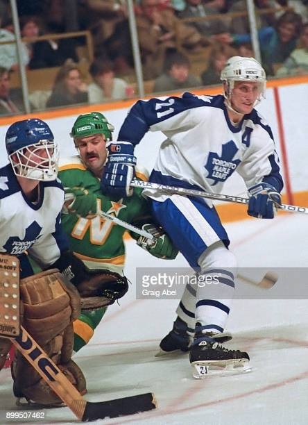 Borje Salming and Ken Wregget of the Toronto Maple Leafs skates against Dennis Maruk of the Minnesota North Stars during NHL game action on December...