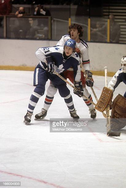 Borje Salming of the Toronto Maple Leafs sets up in front of the net as Rod Seiling of the New York Rangers defends circa 1975 at the Madison Square...