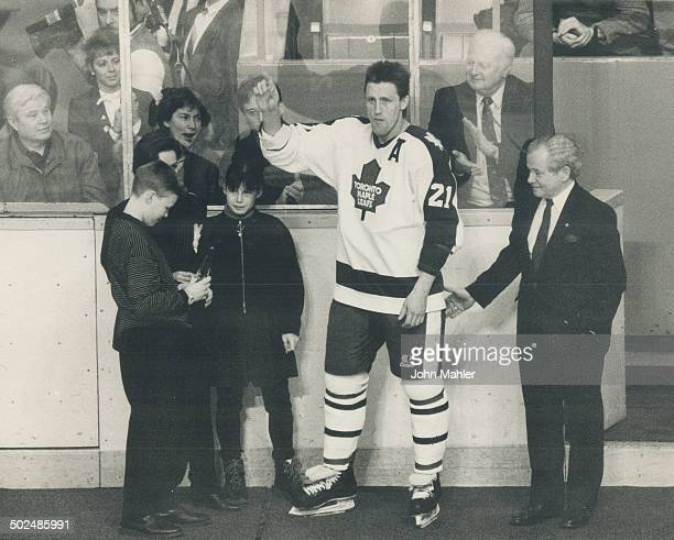 Borje's big night NHL vicepresident Scotty Morrison right presented the Leafs' Borje Salming with the league's 1000game milestone award being admired...