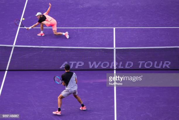 Borma Coric from Croatia and Denis Shapovalov from Canada playing the last point of the match both at the net during his fourth round match at the...