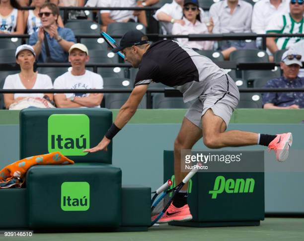 Borma Coric from Croatia crashes against one the benches during his match versus Denis Shapovalov from Canada at the Miami Open in Key Biscayne Coric...