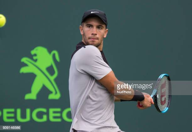 Borma Coric from Croatia in action against Denis Shapovalov from Canada during his fourth round match at the Miami Open in Key Biscayne Coric...