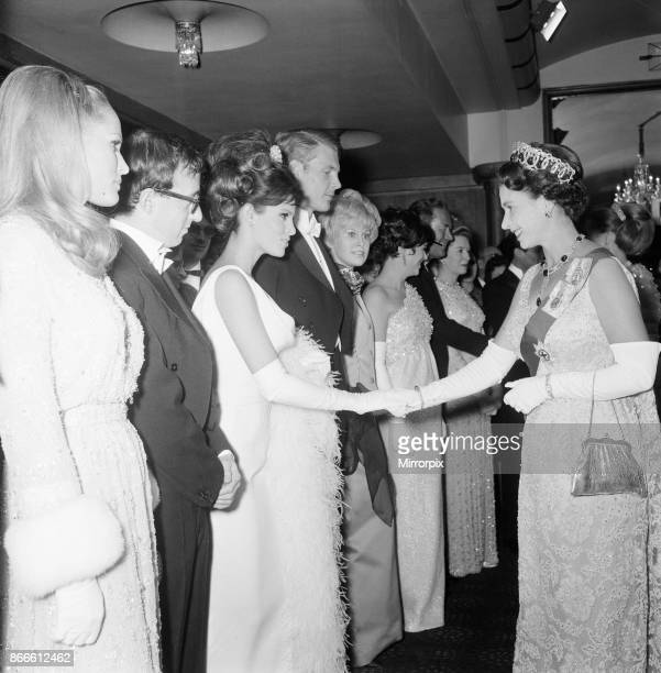 Born Free 1966, Royal Film Performance, The Odeon, Leicester Square, London, Monday 14th March 1966, picture shows The Queen shakes hands with...