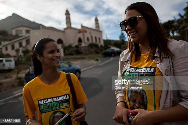 'Born Free' Ashanti Meter talks with her sister in law Servallyn Meter outside of the Hangberg Sports and Recreation Centre voting station on May 7...