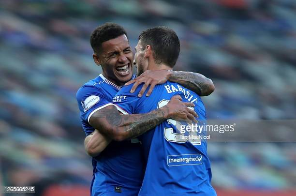 Borna Barisic of Rangers FC celebrates with James Tavernier after scoring his team's first goal during the Ladbrokes Scottish Premiership match...