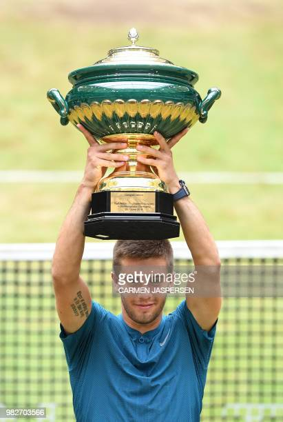 Borna Coric from Croatia poses with his trophy after defeating Roger Federer of Switzerland in their final match at the ATP tennis tournament in...