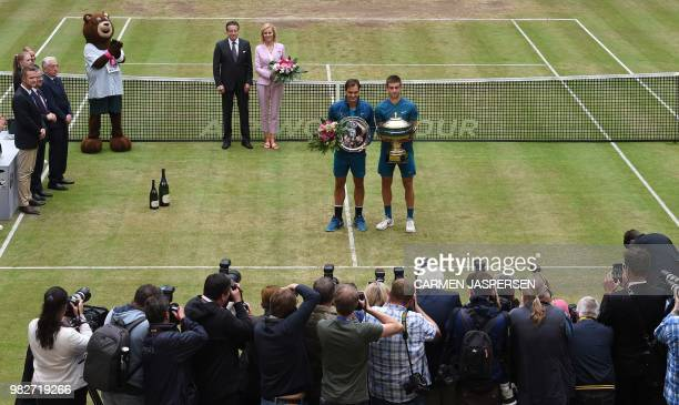 Borna Coric from Croatia poses with Roger Federer of Switzerland after defeating him in their final match at the ATP tennis tournament in Halle...