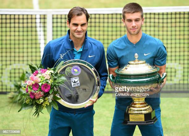 Borna Coric from Croatia poses with Roger Federer of Switzerland after defeating him in their final match at the ATP tennis tournament in Halle,...