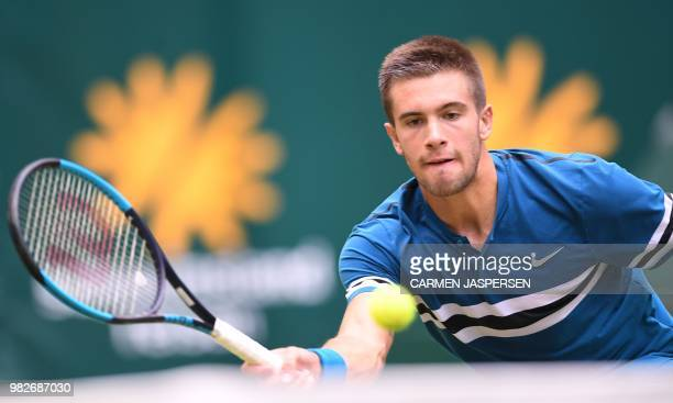 TOPSHOT Borna Coric from Croatia returns the ball to Roger Federer of Switzerland during the final match at the ATP tennis tournament in Halle...