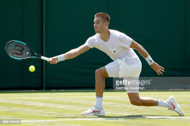 Borna Coric of Craotia practices on court during training for the Wimbledon Lawn Tennis Championships at the All England Lawn Tennis and Croquet Club...