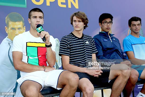 Borna Coric of Croatia address the audiance while participating in the ATP #NextGen player panel with Alexander Zverev of Germany and Hyeon Chung of...