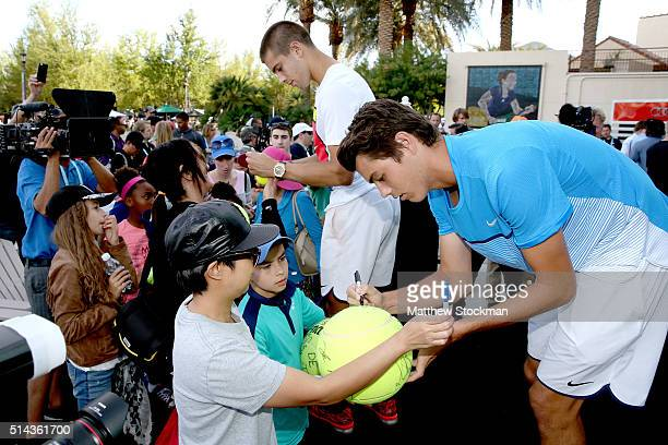 Borna Coric of Croatia and Taylor Fritz sign autographs after participating in the ATP #NextGen player panel during the BNP Paribas Open at the...