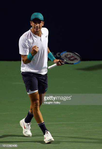 Borna Coric of Croatia celebrates a point against Vasek Pospisil of Canada during a 1st round match on Day 1 of the Rogers Cup at Aviva Centre on...