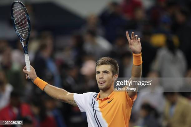 Borna Coric of Croatia celebrates after defeating against Roger Federer of Switzerland during their Singles Semifinals match of the 2018 Rolex...