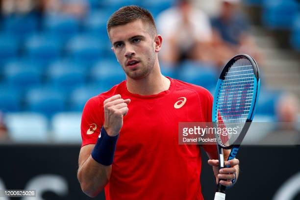 Borna Coric of Croatia celebrates after winning a point during his Men's Singles first round match against Sam Querrey of the United States of...