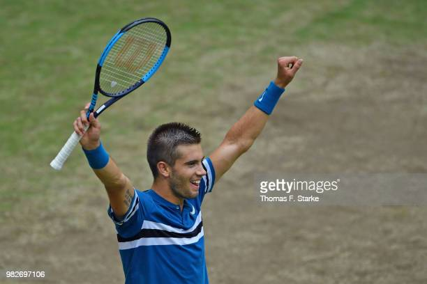 Borna Coric of Croatia celebrates after winning the final match against Roger Federer of Switzerland during day seven of the Gerry Weber Open at...