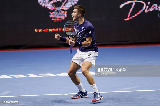 Borna Coric of Croatia celebrates during his ATP St. Petersburg Open 2020 international tennis tournament semi-final match against Milos Raonic of...