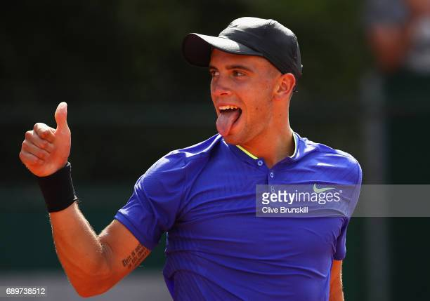 Borna Coric of Croatia celebrates during the mens singles first round match against Mathias Bourgue of France on day two of the 2017 French Open at...