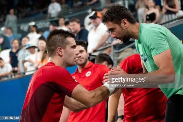 Borna Coric of Croatia celebrates his win over Dominic Thiem of Austria during day two of the Group singles match at the 2020 ATP Cup Tennis at Ken...