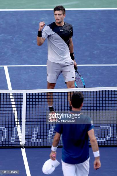 Borna Coric of Croatia celebrates his win over Roberto Bautista Agut of Spain during the BNP Paribas Open at the Indian Wells Tennis Garden on March...