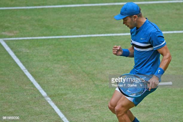 Borna Coric of Croatia celebrates in his half final match against Roberto Bautista Agut of Spain during day six of the Gerry Weber Open at Gerry...