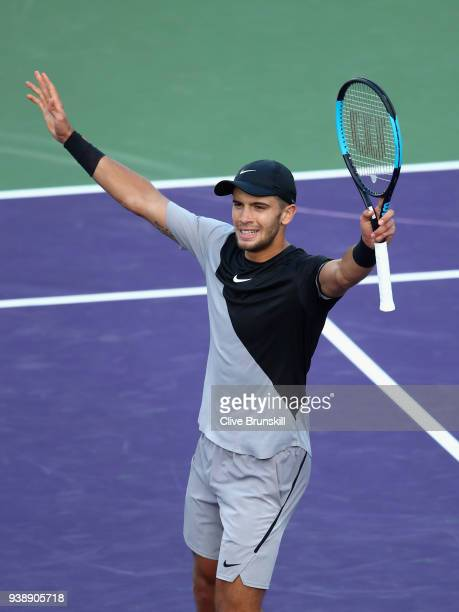 Borna Coric of Croatia celebrates match point against Denis Shapovalov of Canada in their fourth round match during the Miami Open Presented by Itau...