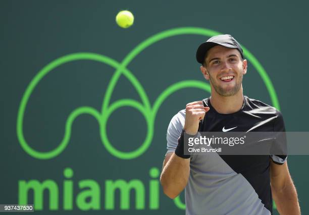 Borna Coric of Croatia celebrates match point against Leonardo Mayer of Argentina in their second round match during the Miami Open Presented by Itau...