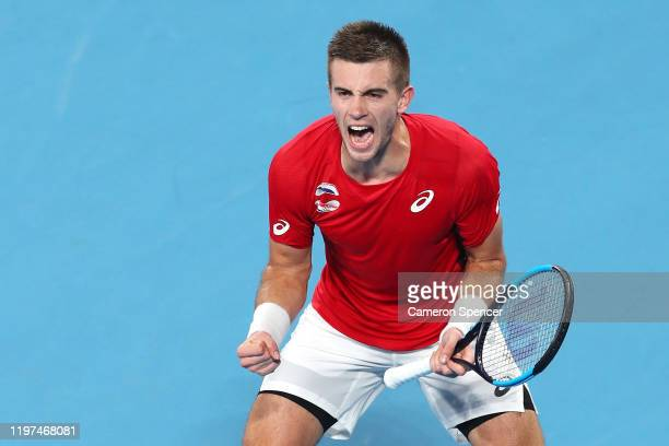 Borna Coric of Croatia celebrates match point during his group E singles match against Dominic Thiem of Austria celebrates winning a point during day...