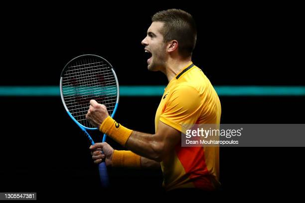 Borna Coric of Croatia celebrates victory in his match against Kei Nishikori of Japan during Day 5 of the 48th ABN AMRO World Tennis Tournament at...