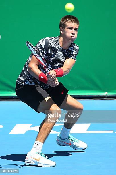 Borna Coric of Croatia hits a backhand shot in his match against Pablo Carreno Busta of Spain during day two of the 2015 Heineken Open Classic at...