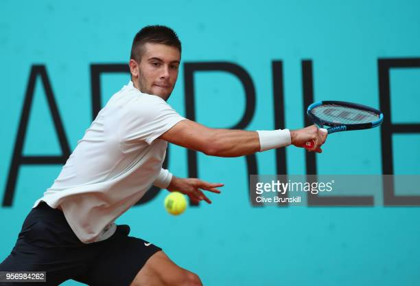 Borna Coric of Croatia in action against Dominic Thiem of Austria in their third round match during day six of the Mutua Madrid Open tennis...