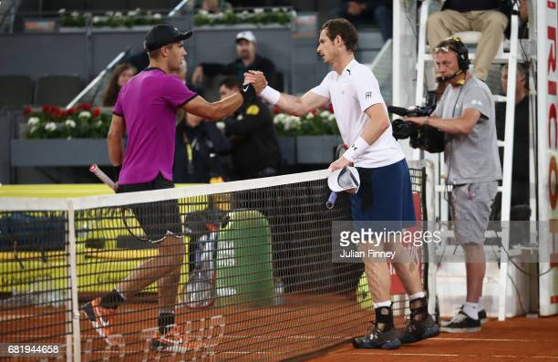Borna Coric of Croatia is congratulated by Andy Murray of Great Britain after his straight sets win during day six of the Mutua Madrid Open tennis at...