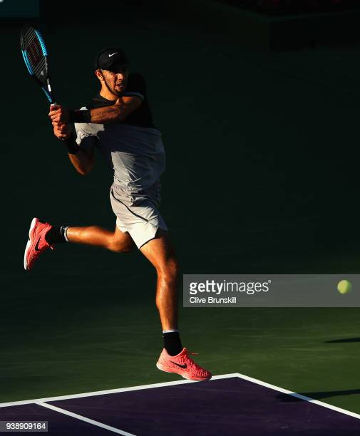 Borna Coric of Croatia plays a backhand against Denis Shapovalov of Canada in their fourth round match during the Miami Open Presented by Itau at...