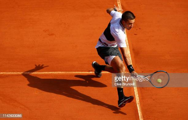 Borna Coric of Croatia plays a backhand against Hubert Hurkacz of Poland in their first round match during Day One of the Rolex MonteCarlo Masters at...