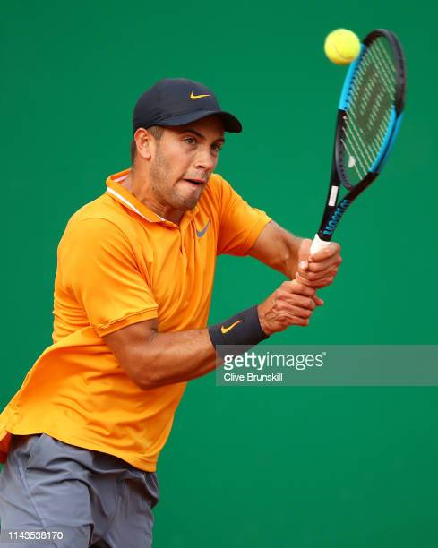 Borna Coric of Croatia plays a backhand against Pierre-Hugues Herbert of France in their third round match during day five of the Rolex Monte-Carlo...