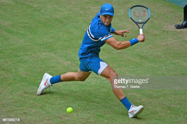 Borna Coric of Croatia plays a backhand in his half final match against Roberto Bautista Agut of Spain during day six of the Gerry Weber Open at...