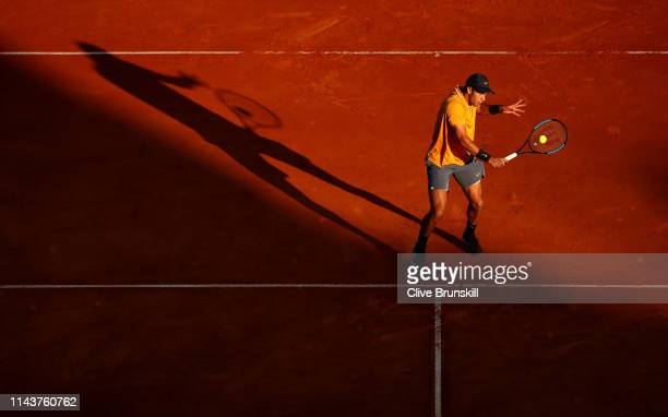 Borna Coric of Croatia plays a backhand volley against Fabio Fognini of Italy in their quarter final match during day six of the Rolex MonteCarlo...