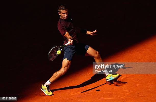 Borna Coric of Croatia plays a forehand against Novak Djokovic of Serbia in their second round match during day five of the Mutua Madrid Open tennis...