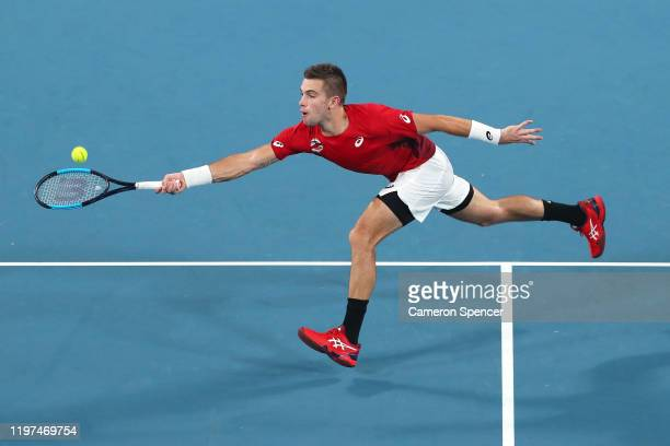 Borna Coric of Croatia plays a forehand during his group E singles match against Dominic Thiem of Austria celebrates winning a point during day two...