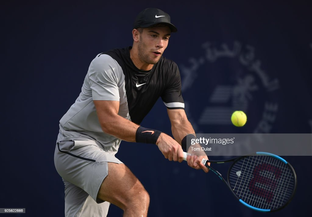 Borna Coric of Croatia plays a forehand during his quarter final match against Roberto Bautista Agut of Spain on day four of the ATP Dubai Duty Free Tennis Championships at the Dubai Duty Free Stadium on March 1, 2018 in Dubai, United Arab Emirates.
