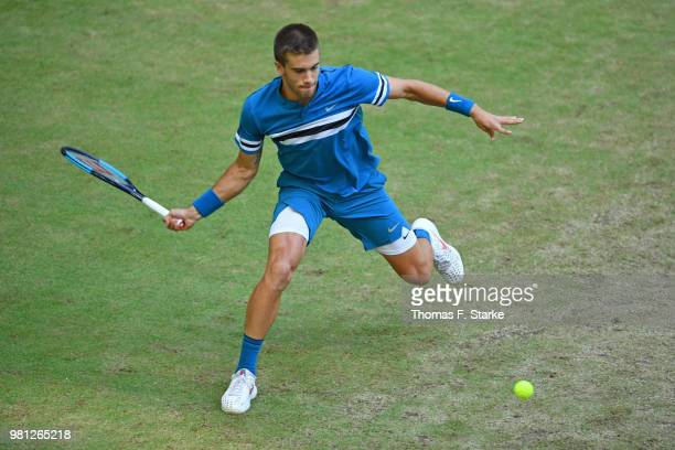 Borna Coric of Croatia plays a forehand in his match against Andreas Seppi of Italy during day five of the Gerry Weber Open at Gerry Weber Stadium on...