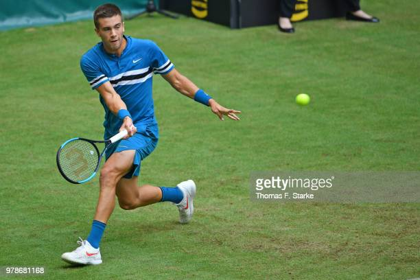 Borna Coric of Croatia plays a forehand in his match against Alexander Zverev of Germany during day two of the Gerry Weber Open at Gerry Weber...