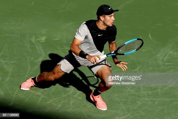 Borna Coric of Croatia plays Roberto Bautista Agut of Spain during the BNP Paribas Open at the Indian Wells Tennis Garden on March 12 2018 in Indian...