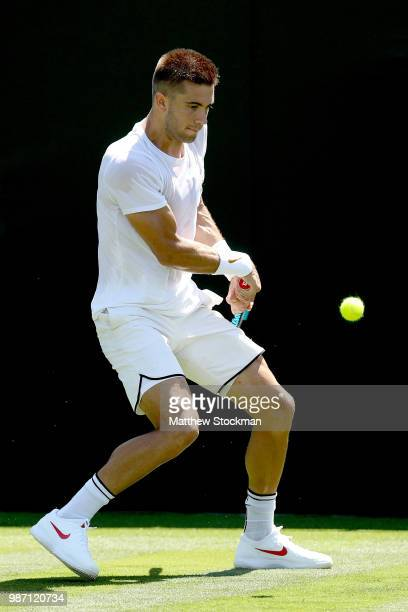 Borna Coric of Croatia practices on court during training for the Wimbledon Lawn Tennis Championships at the All England Lawn Tennis and Croquet Club...