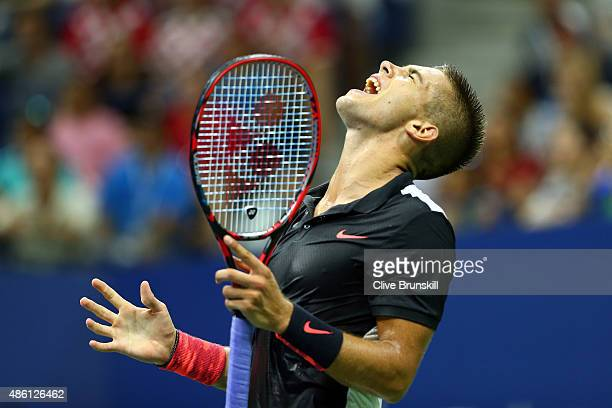 Borna Coric of Croatia reacts after a point to Rafael Nadal of Spain during their Men's Singles First Round match on Day One of the 2015 US Open at...