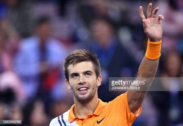 TOPSHOT Borna Coric of Croatia reacts after winning against Roger Federer of Switzerland in their men's singles semifinal match at the Shanghai...