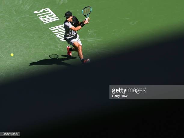 Borna Coric of Croatia returns a backhand in his quarterfinal match against Kevin Anderson of South Africa during the BNP Paribas Open at the Indian...