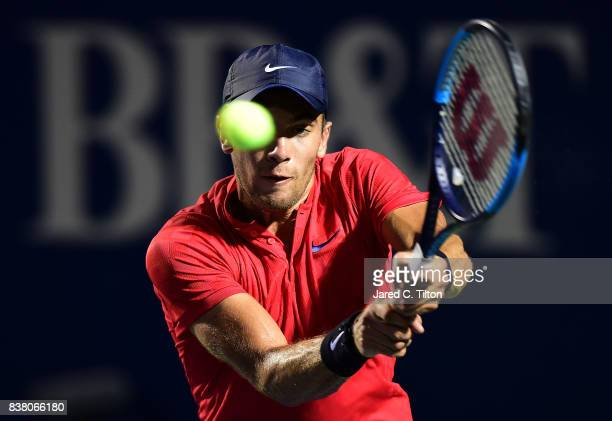 Borna Coric of Croatia returns a shot to John Isner during the fifth day of the Winston-Salem Open at Wake Forest University on August 23, 2017 in...