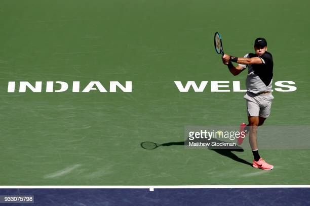 Borna Coric of Croatia returns a shot to Roger Federer of Switzerland during the semifinals of the BNP Paribas Open at the Indian Wells Tennis Garden...