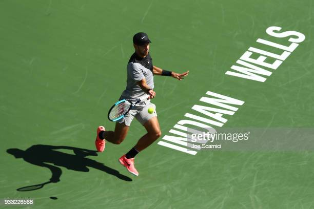 Borna Coric of Croatia returns a shot to Roger Federer of Switzerland during their semifinal match at BNP Paribas Open Day 13 on March 17 2018 in...